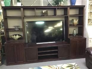 LARGE ENTERTAINMENT UNITHOLDS BIG SCREEN TV