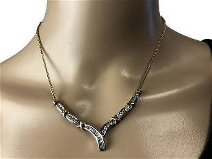 DIAMOND AND TWO-TONE GOLD NECKLACE.