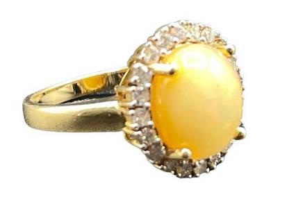 OPAL, DIAMOND AND FOURTEEN KARAT GOLD RING