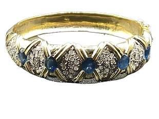 SAPPHIRE, DIAMOND AND 14 K GOLD BANGLE.
