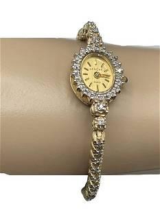 GENEVE LADIES 14K GOLD AND DIAMOND WATCH