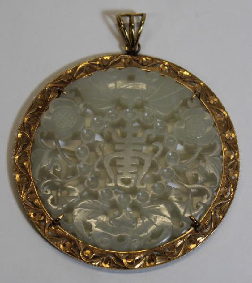 JEWELRY. 14kt Gold and Carved Jade Pendant.
