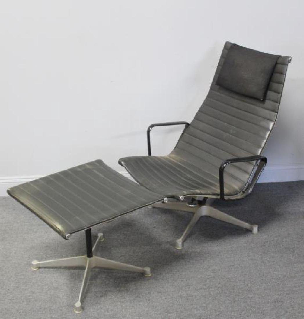 Eames Alumnium Group Chair and Ottoman.