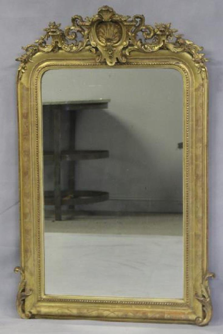 Antique Giltwood Mirror with Shell Crown.