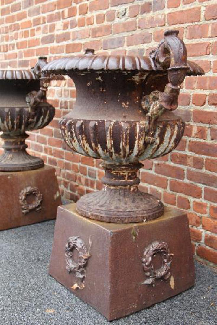 Pair Of Antique Cast Iron Urns On Stands . - 4