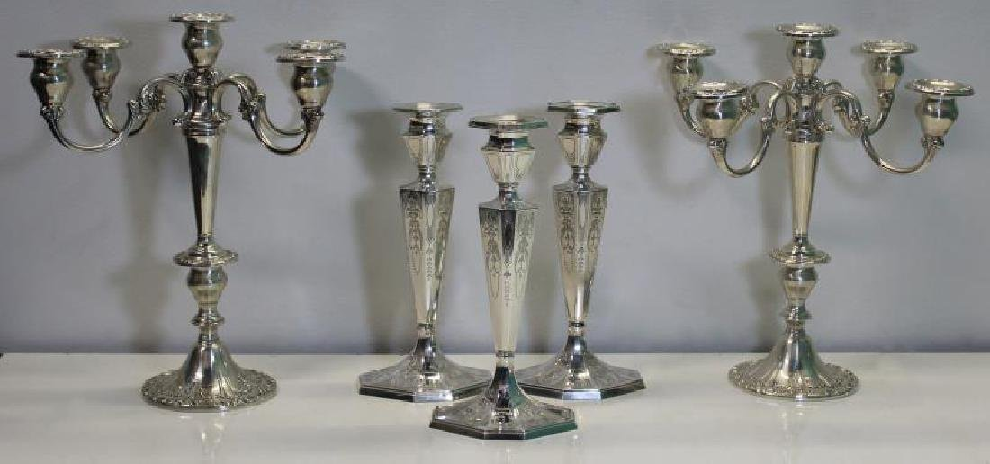 STERLING. Grouping of Candlesticks and Candelabra.