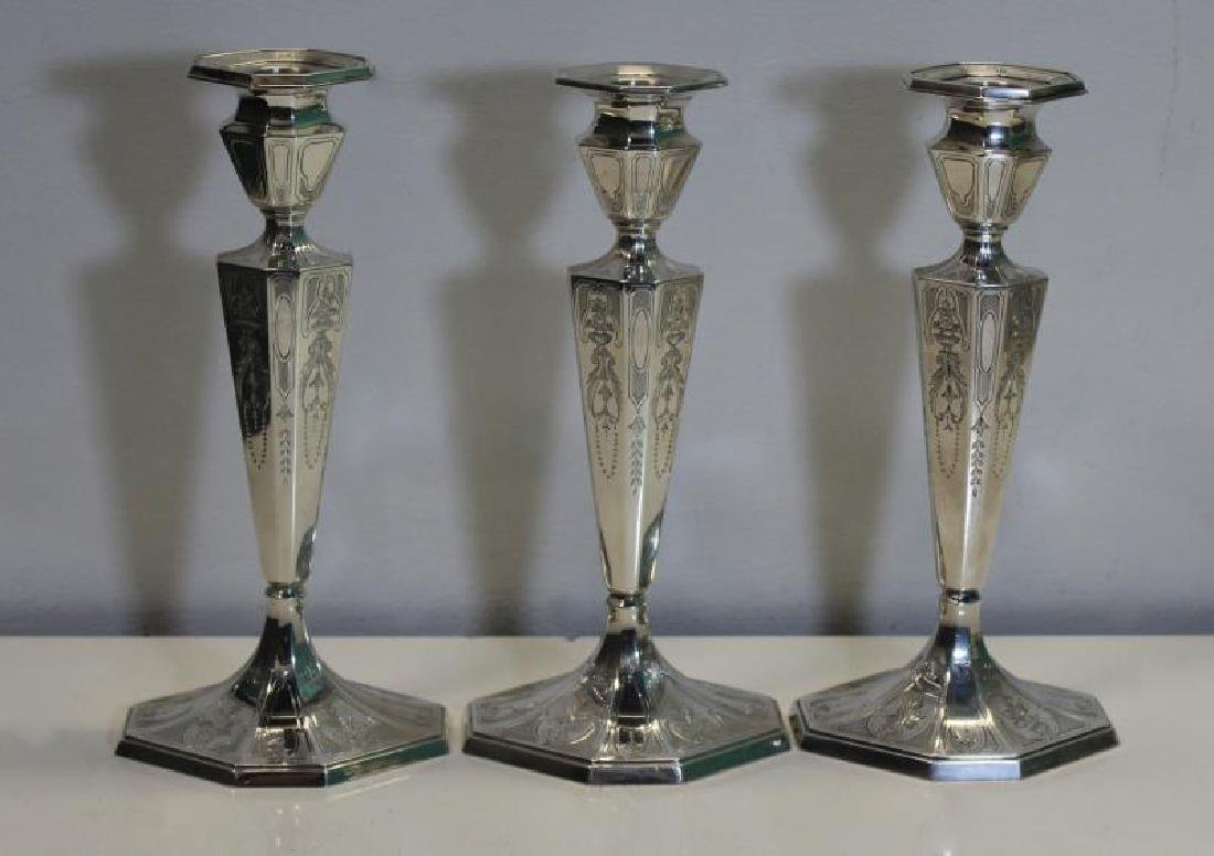 STERLING. Grouping of Candlesticks and Candelabra. - 4