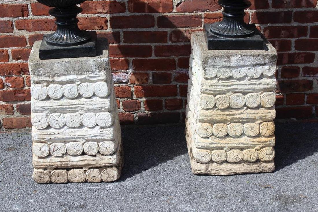 Pair of Cast Iron Urns on Painted Portland Bases. - 2