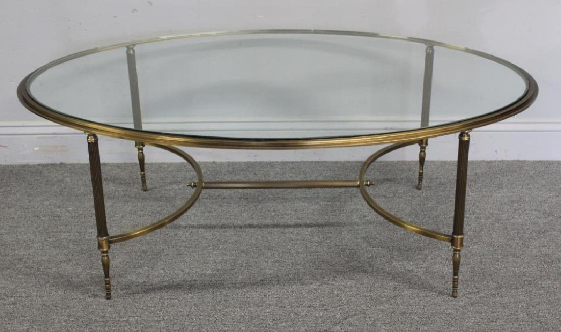 Oval Brass Cocktail Table with Glass Top.