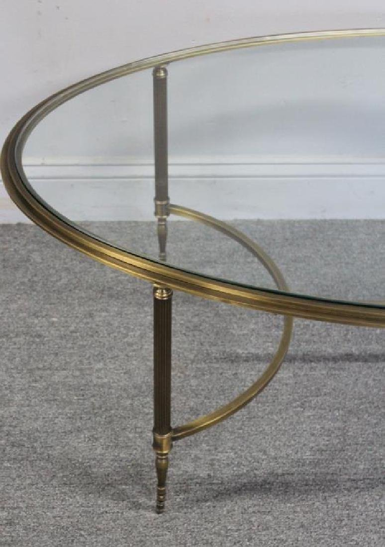 Oval Brass Cocktail Table with Glass Top. - 2