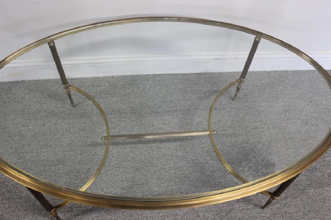 Oval Brass Cocktail Table with Glass Top. - 3