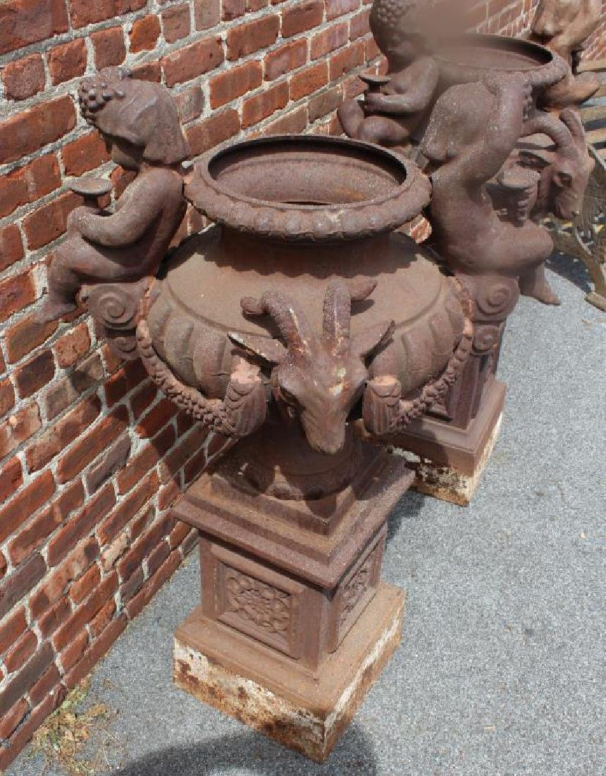 A Pair Of Cast iron Figural Urns On Stands . - 4
