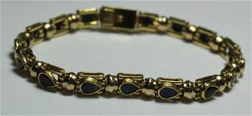 JEWELRY. Signed 18kt Gold and Sapphire Bracelet.