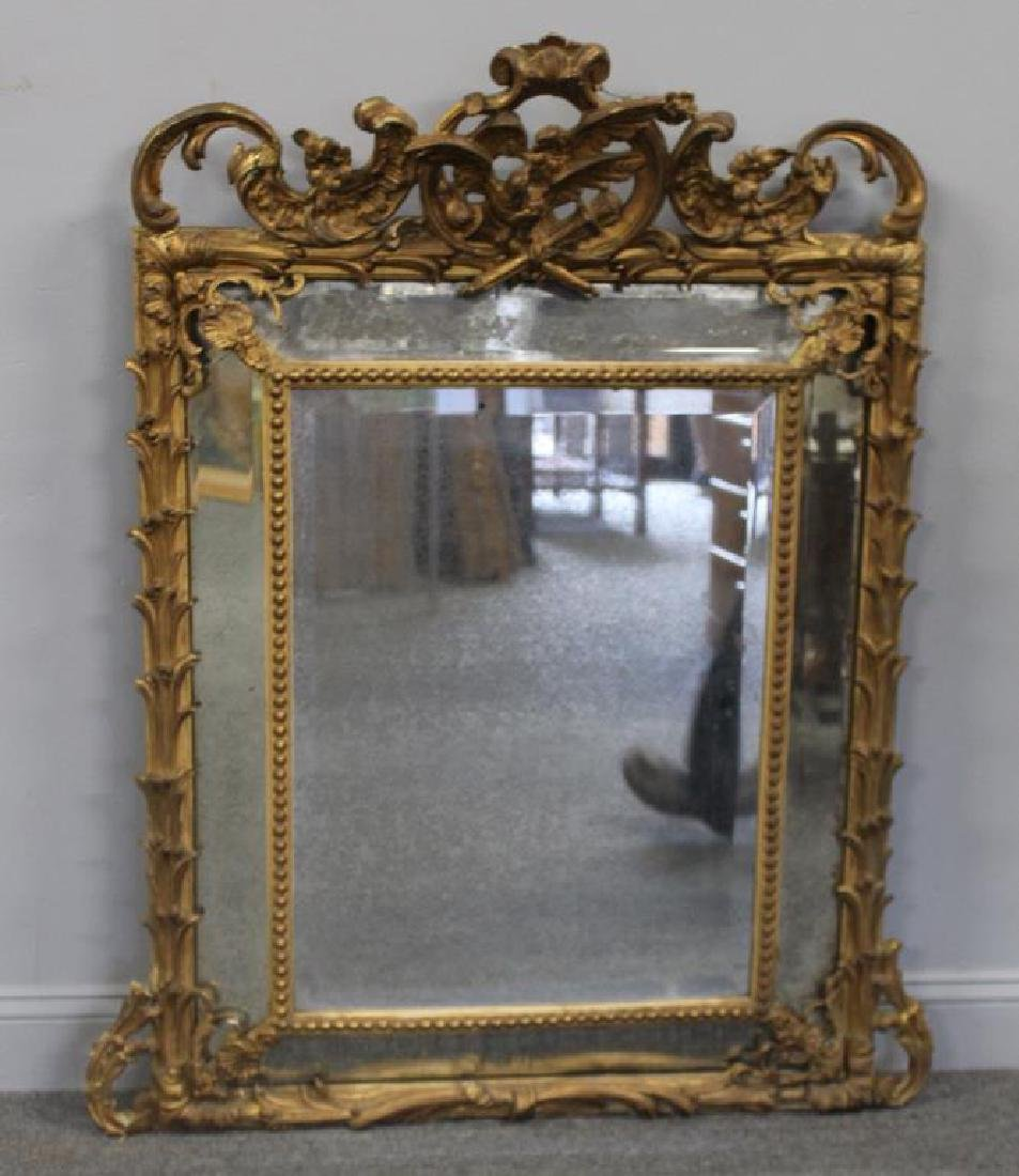 19 Century Carved Giltwood and Gessoe Mirror.