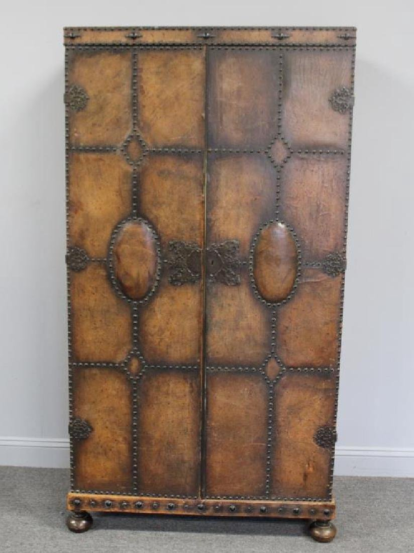 Antique Leather Covered 2 Door Armoire.
