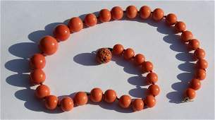 JEWELRY. Single Strand Graduated Coral Necklace.