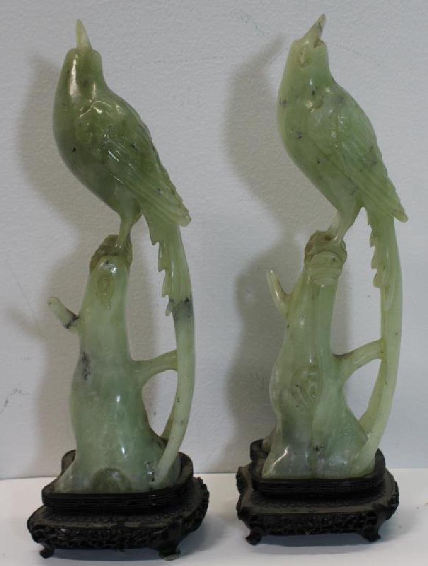 An Antique Pair of Jade Birds on Stands.