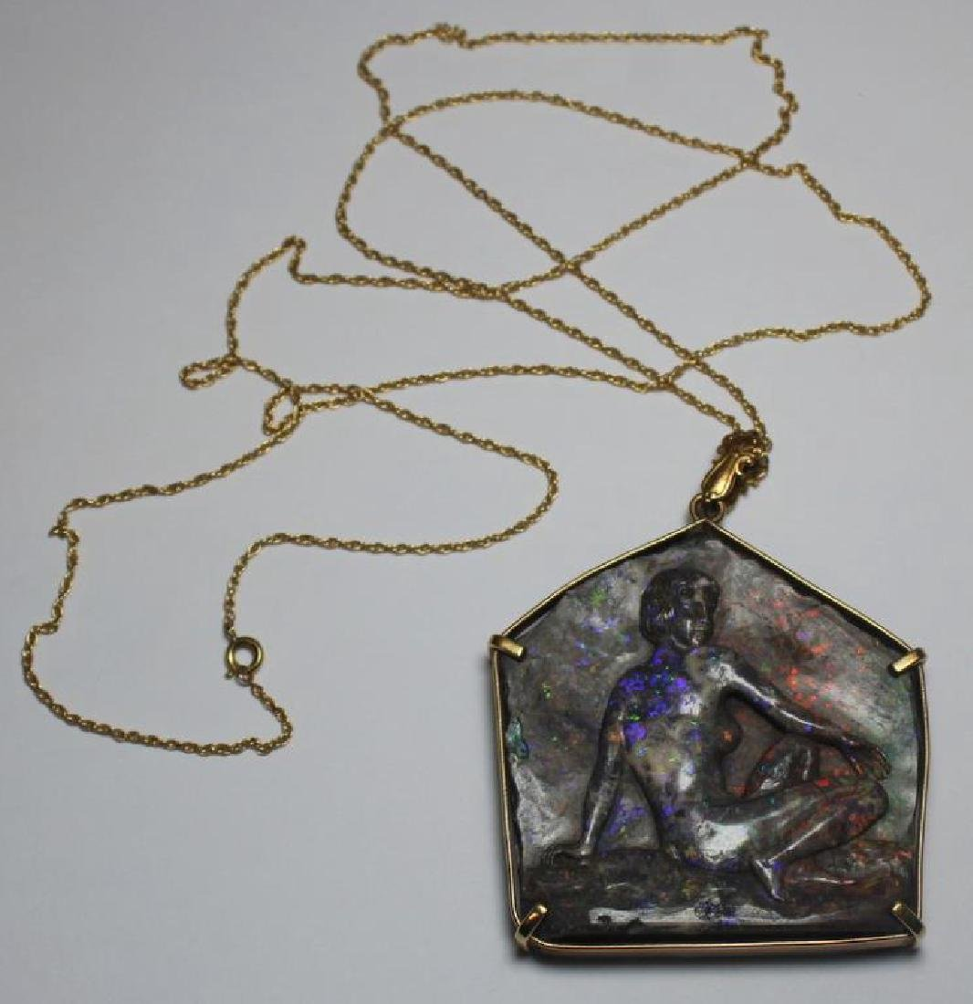 JEWELRY. Carved Phenomenal Stone and Gold Pendant.