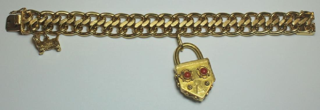 JEWELRY. 14kt Gold Link Bracelet with (2) Charms.