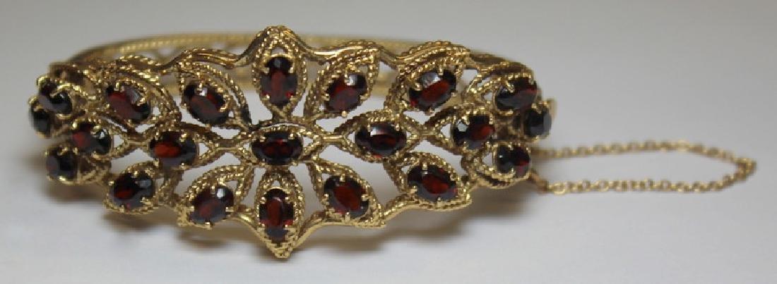 JEWELRY. 14kt Gold and Garnet Openwork Bracelet.
