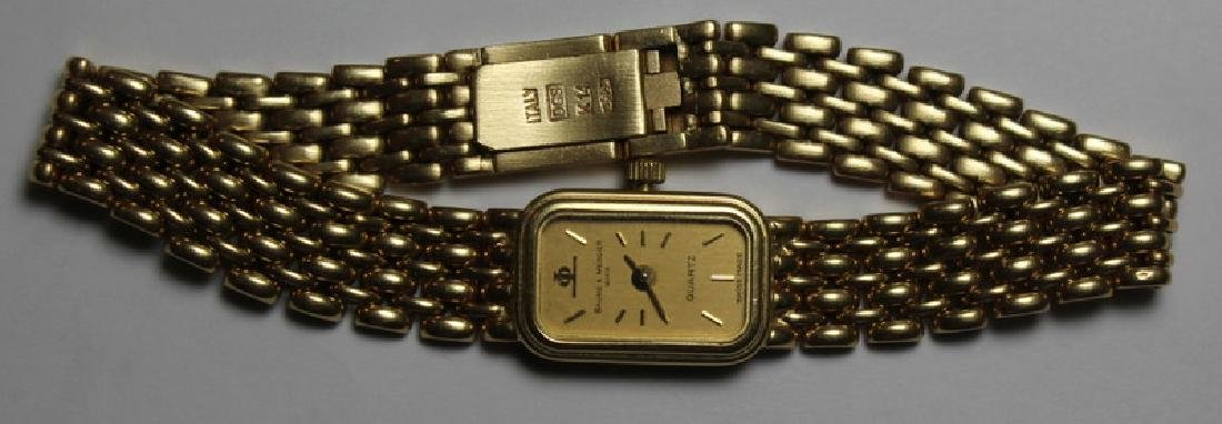 JEWELRY. Ladies 14kt Gold Baume & Mercier Watch.