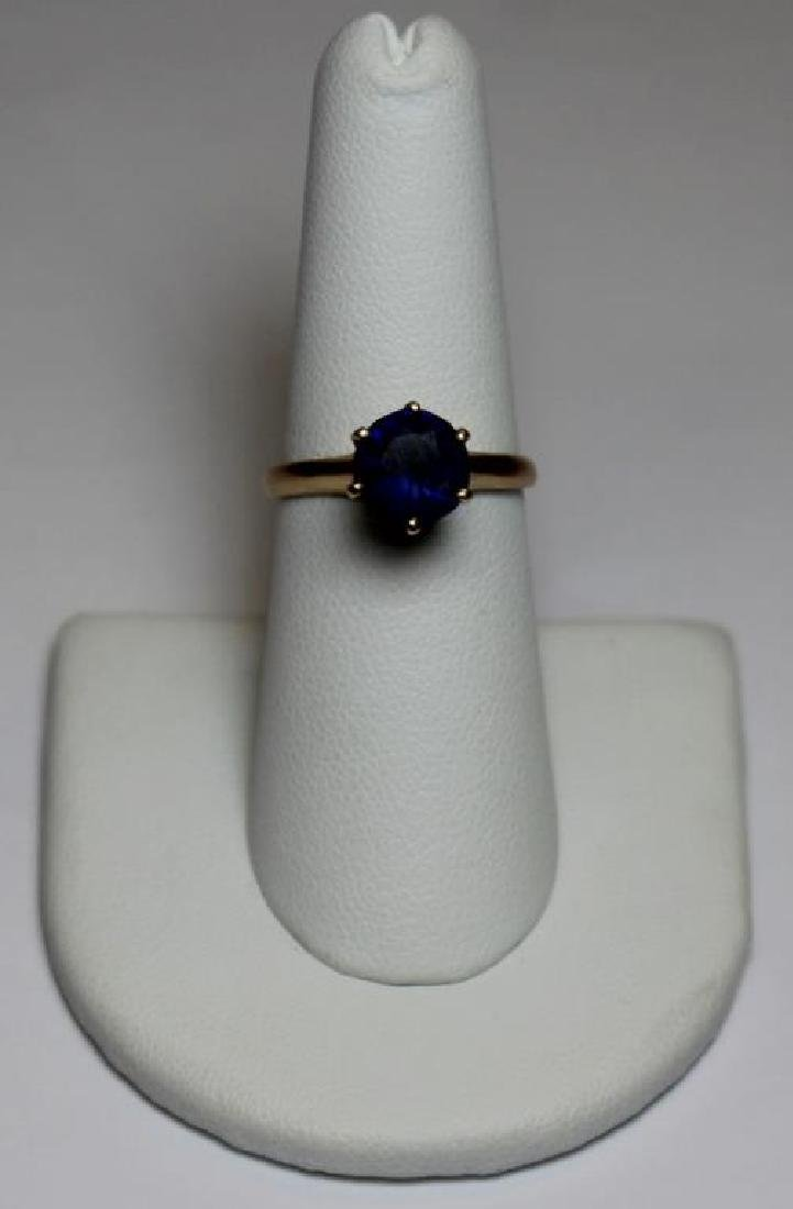 JEWELRY. 14kt Gold and Solitaire Sapphire Ring.