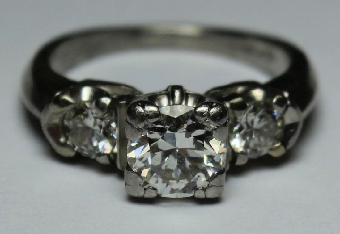JEWELRY. Platinum and Diamond Engagement Ring.