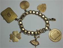 JEWELRY 14kt Gold Charm Bracelet and 7 Charms