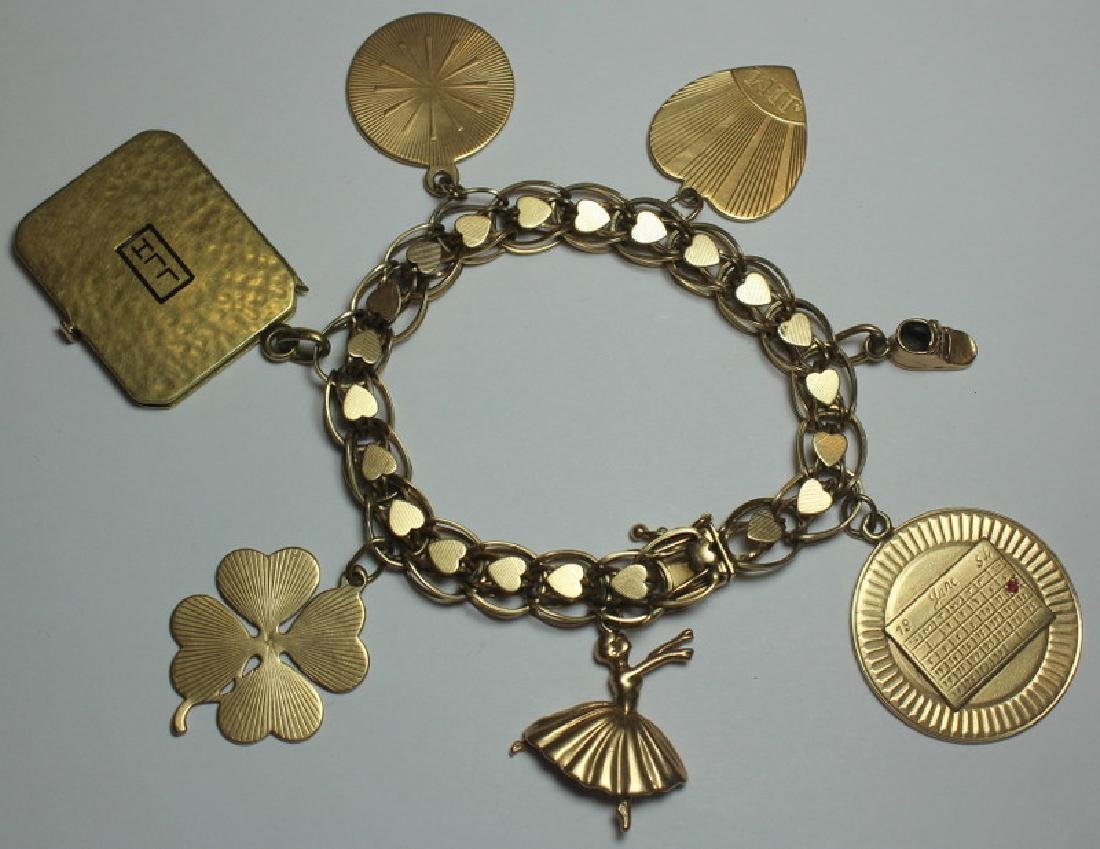 JEWELRY. 14kt Gold Charm Bracelet and 7 Charms.