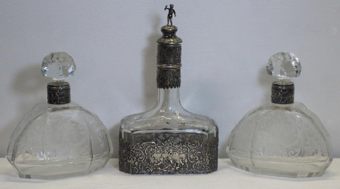 SILVER. Grouping of Silver Mounted Decanters.