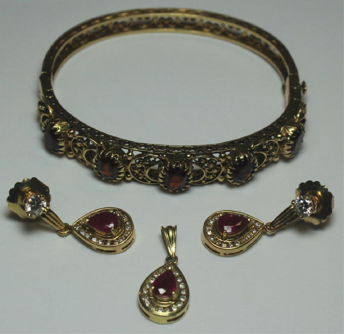 JEWELRY. Gold, Ruby, and Garnet Jewelry Grouping.