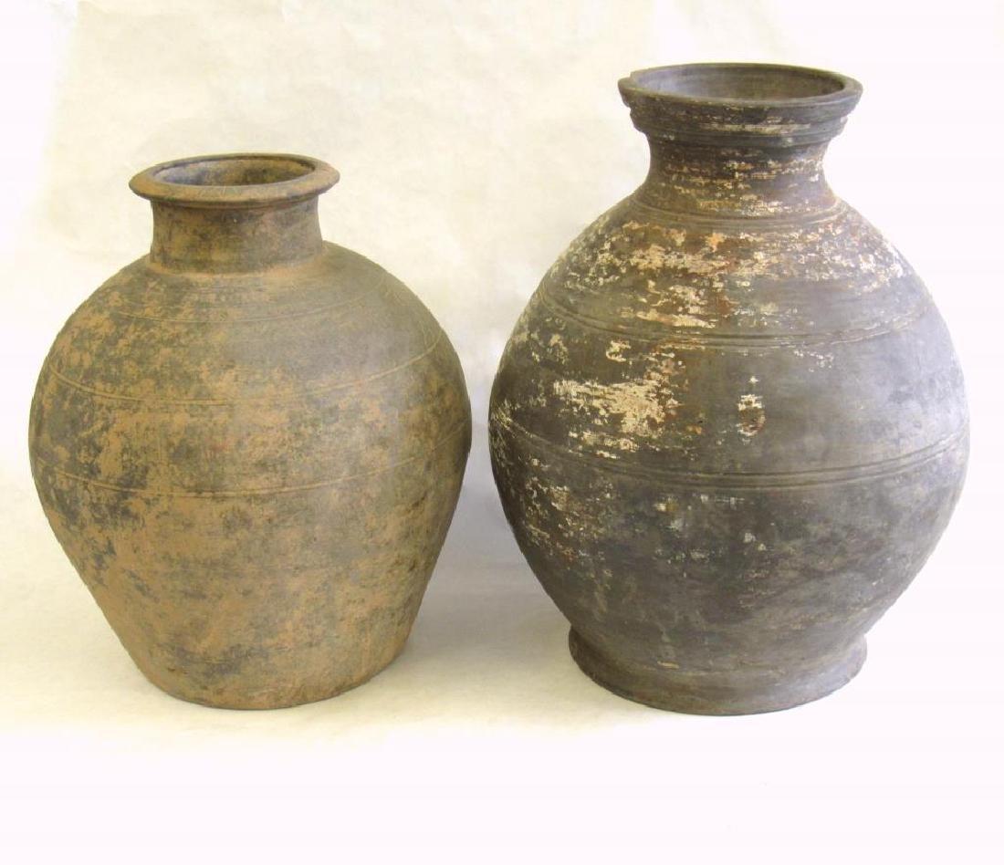Two Black Han Style Funerary Jars.