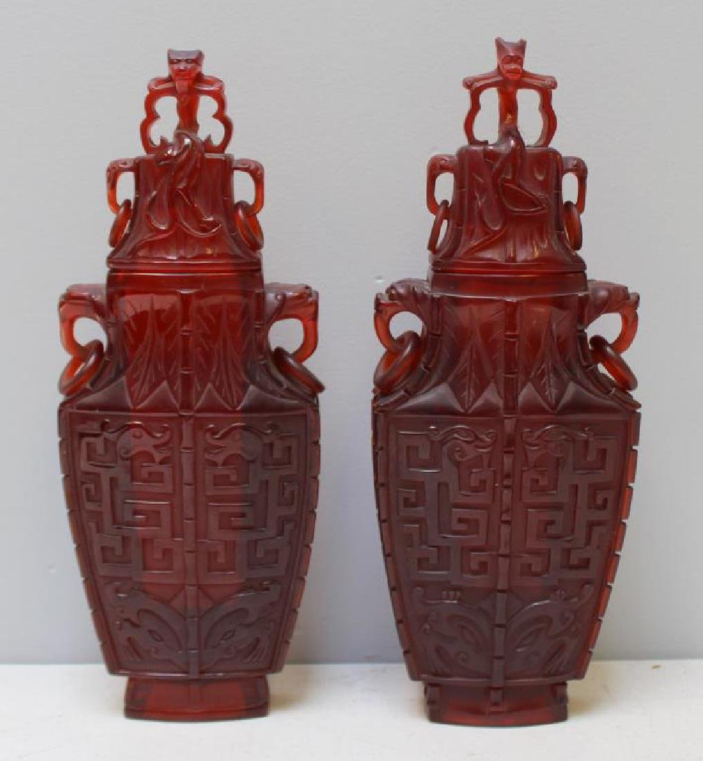 Pair of Carved Chinese Covered Vases.