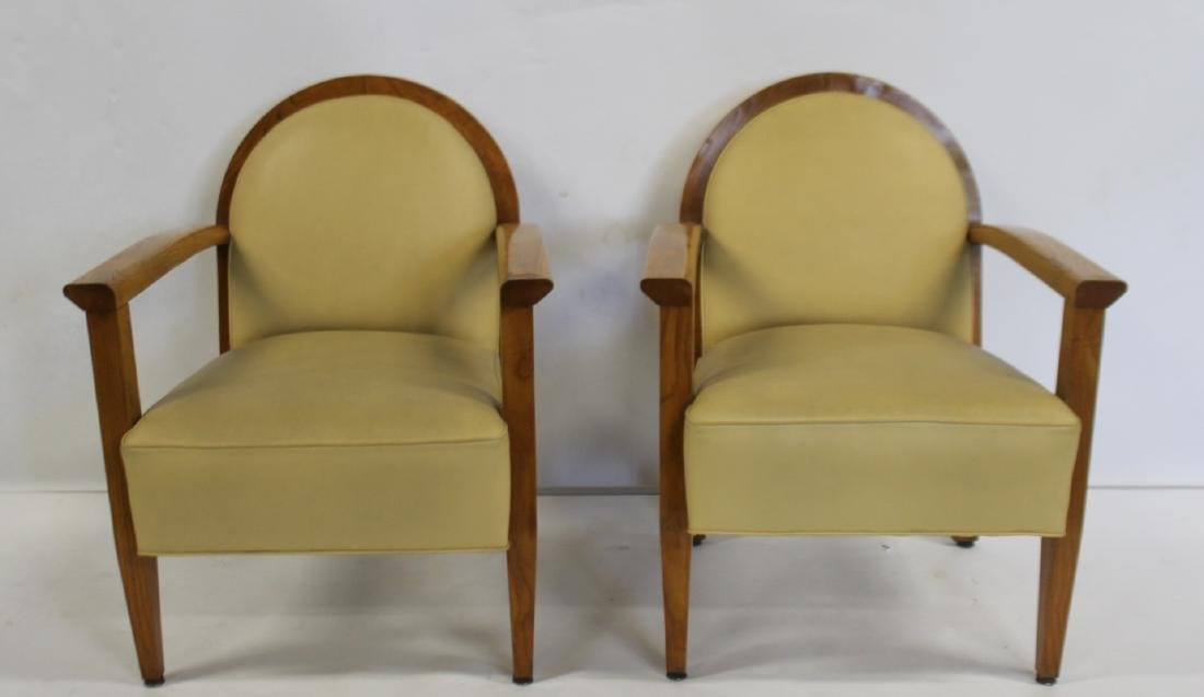 Pair Of Leather Upholstered Art Deco Arm Chairs .