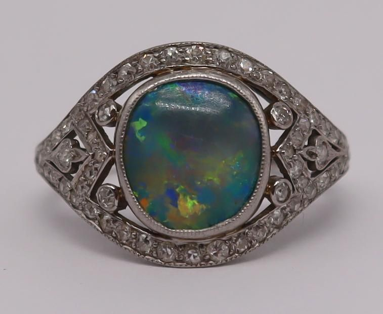 JEWELRY. Signed Platinum, Opal and Diamond Ring.