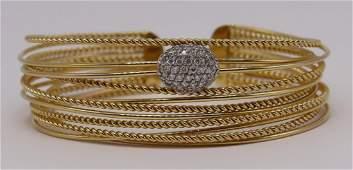 JEWELRY. Signed 14kt Gold and Diamond Bracelet.