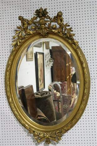 Antique Carved Gilt & Gessoed Oval Mirror.