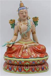Unusual Enamel Decorated Seated Buddha.