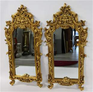 A  Large Pair Of Louis XV Style Carved Giltwood