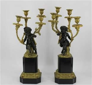 A Fine Pair Of Bronze & Gilt Bronze Candelabra.