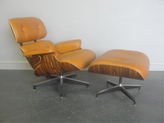 142: EAMES Chair & Ottoman by Herman Miller.