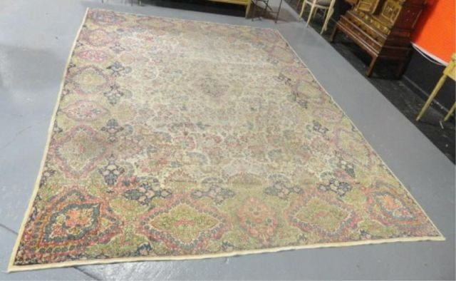 23: Large Openfield Handmade Kirman Carpet.