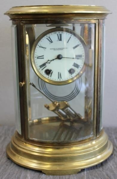 158: French Crystal Regulator Clock in Oval Carved and