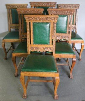 Set Of 6 Carved Oak Dining Chairs With Paw Feet.
