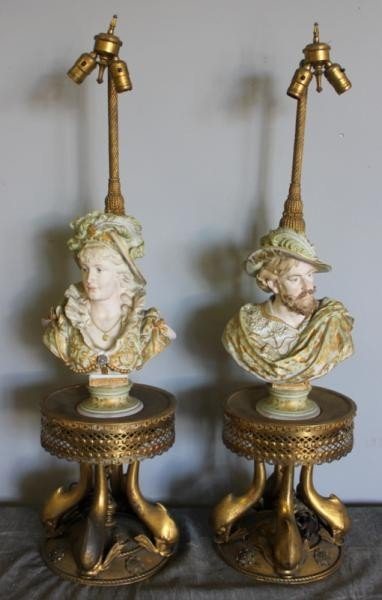 139: Pair of Bisque Lamps on Gilt Bronze Dolphin Bases.