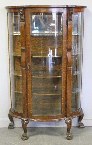 - 258: Curved Glass Oak China Cabinet With Lions Heads