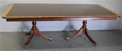 75: Mahogany Banded Twin Pedestal Dining Table.