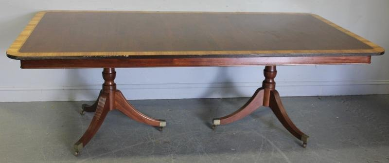 75: Mahogany Banded Twin Pedestal Dining Table.