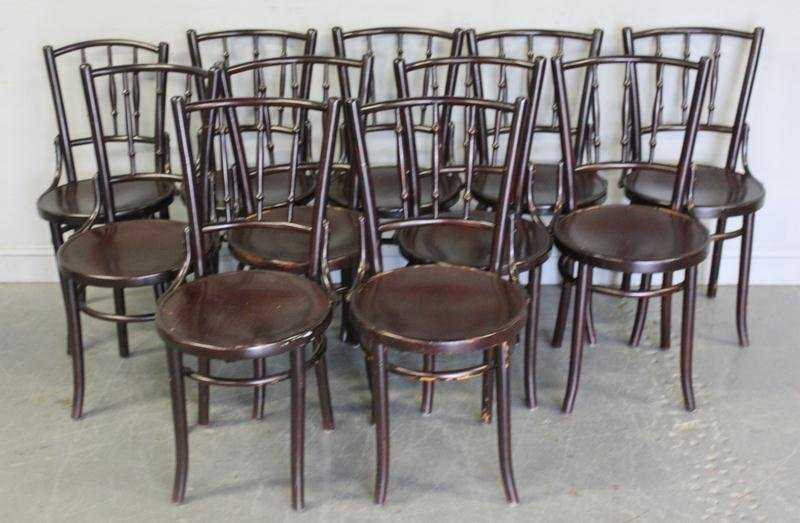 55A: 12 Thonet Black Bentwood Chairs.