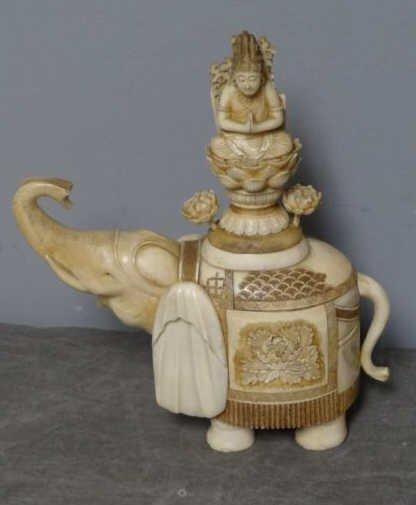 4: Asian Ivory Elephant with Buddhist Figure.